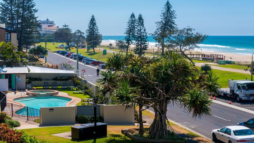 A view of the pool at Sandrift Beachfront Apartments or nearby
