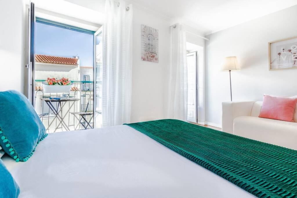 A bed or beds in a room at LoveLisbonApartments Alfama Best Balcony