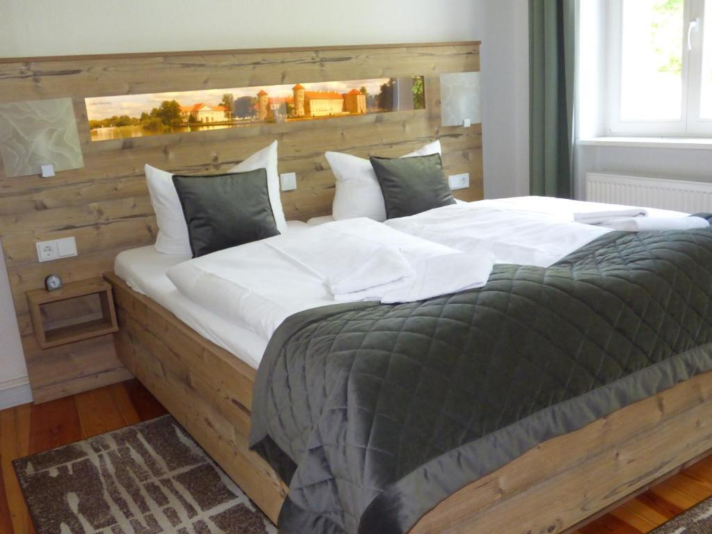 Een bed of bedden in een kamer bij Gasthof & Fleischerei Endler