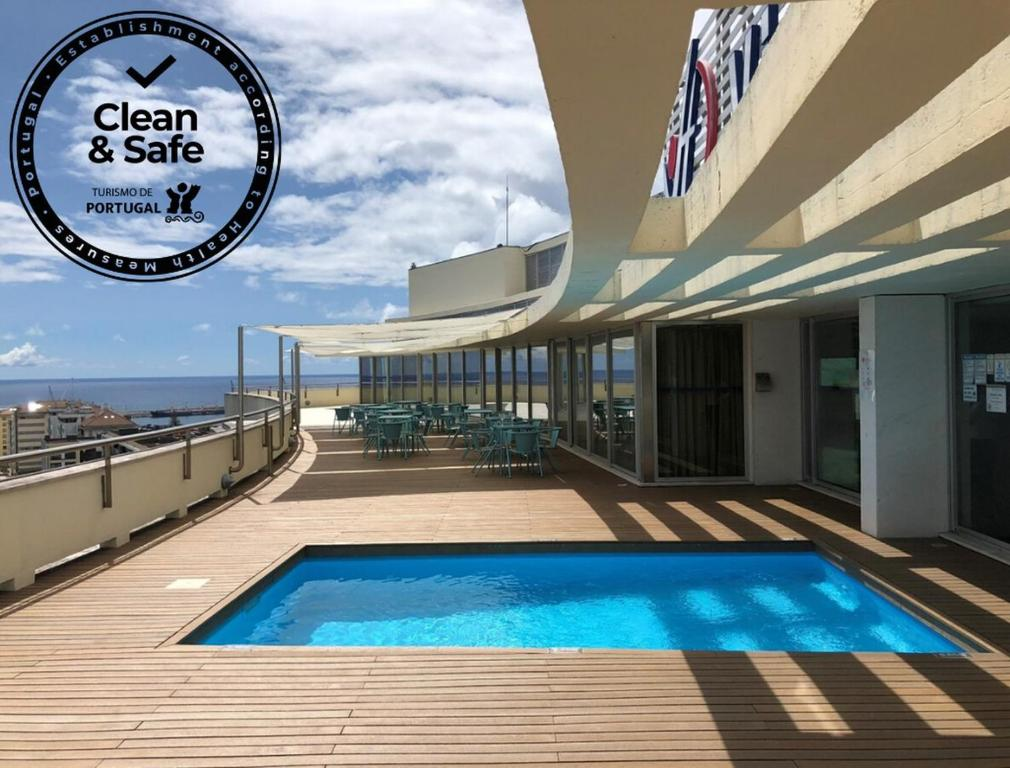 The swimming pool at or near VIP Executive Azores Hotel
