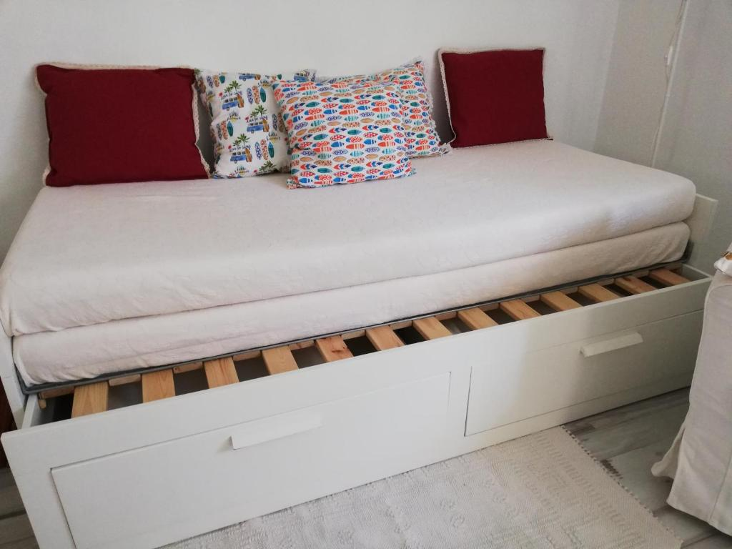 A bed or beds in a room at Moradia Independente TO