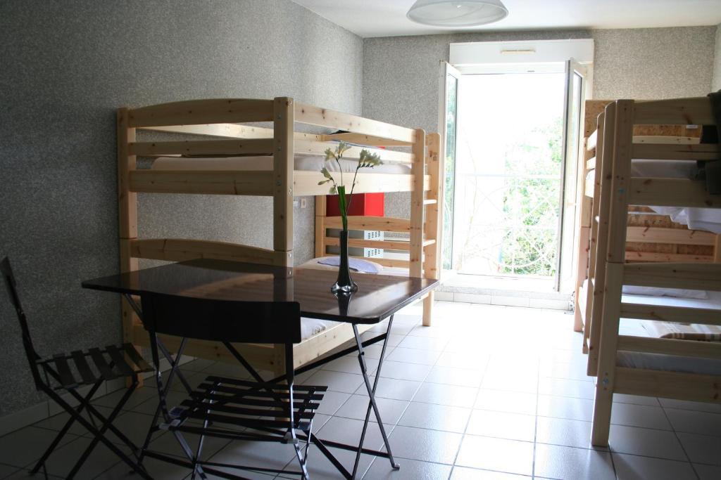 A bunk bed or bunk beds in a room at La Petite Auberge de Saint-Sernin