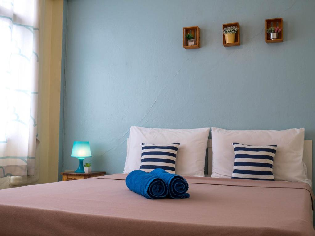 A bed or beds in a room at Chan Cha La 99 Hostel