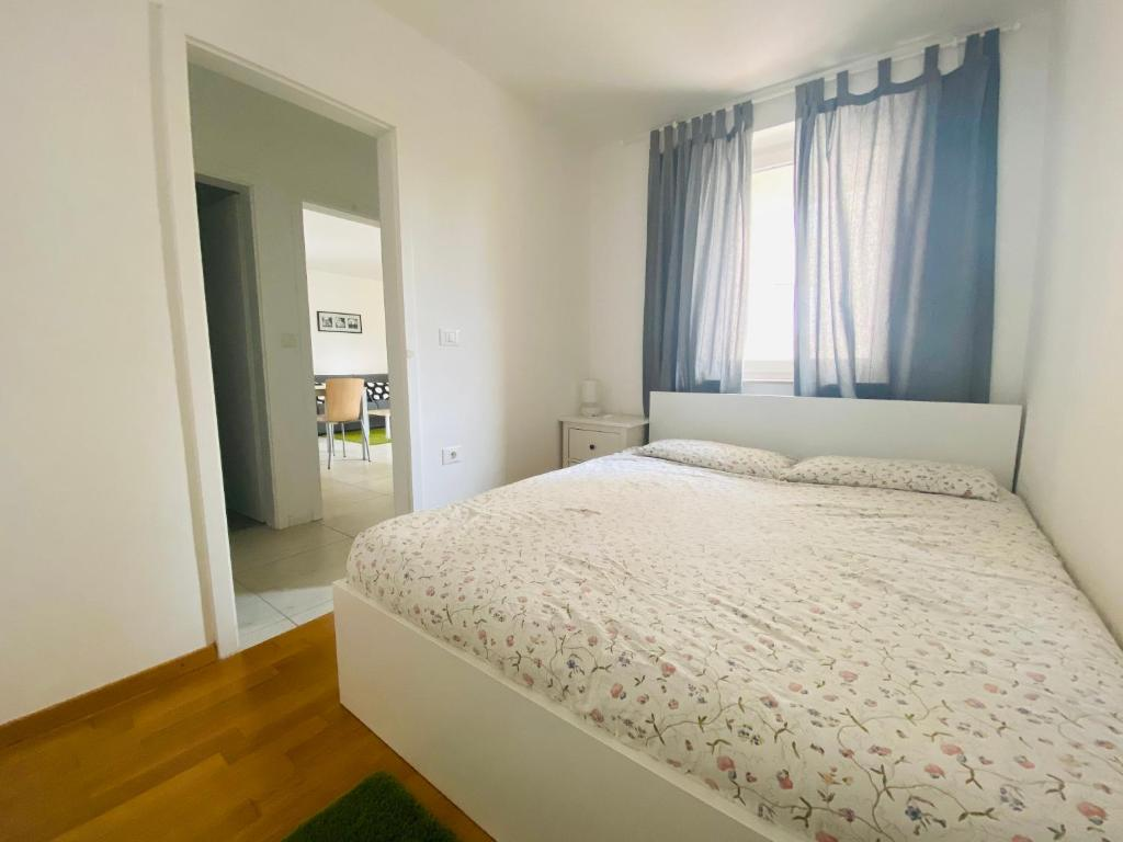 A bed or beds in a room at Apartments Lucija