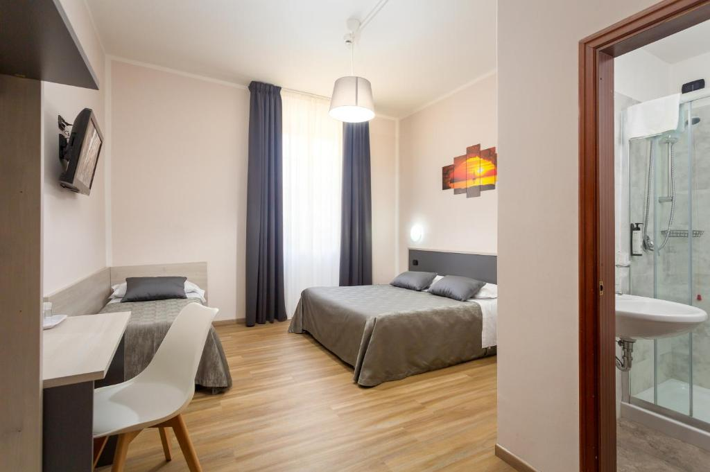 A bed or beds in a room at Hotel Basilea