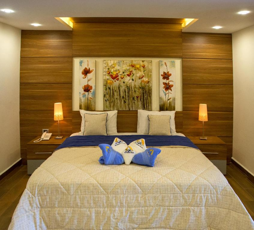A bed or beds in a room at San Stephano Resort
