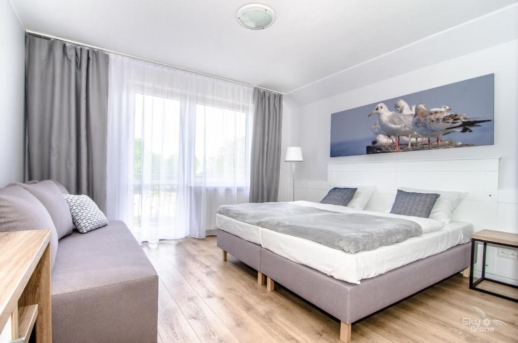 Łóżko lub łóżka w pokoju w obiekcie Villa Chrobry