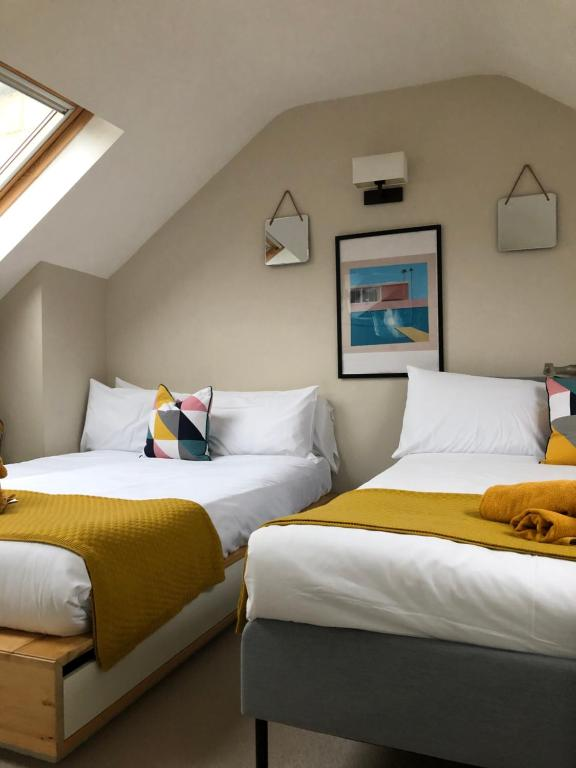 A bed or beds in a room at Available to essential workers