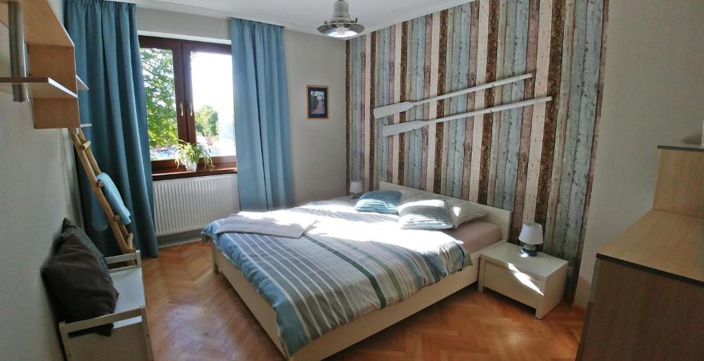 Łóżko lub łóżka w pokoju w obiekcie Gościrada
