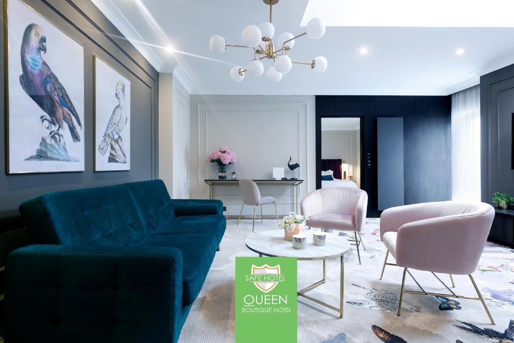 A seating area at Queen Boutique Hotel
