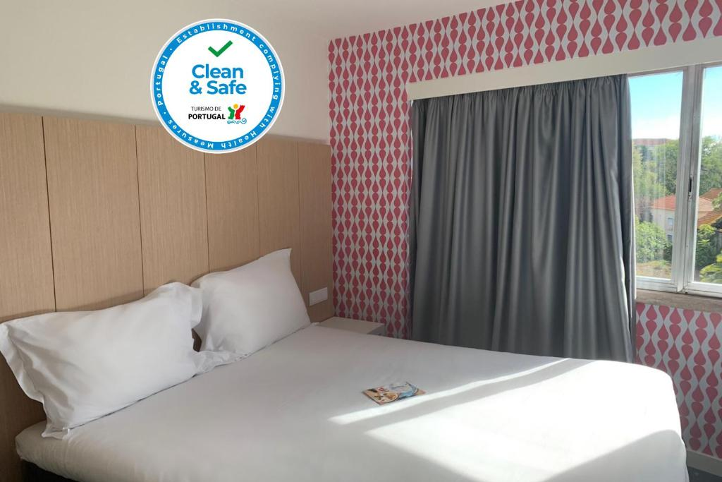 Кровать или кровати в номере Stay Hotel Lisboa Centro Saldanha
