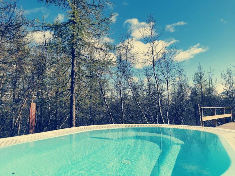 The swimming pool at or near Hotel Kjarnalundur
