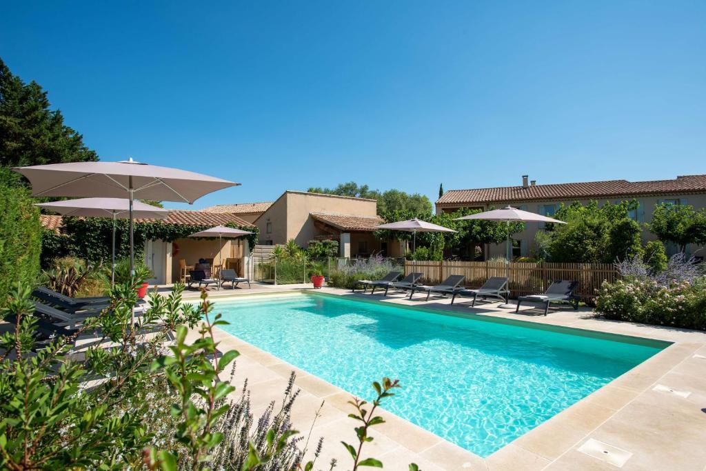 The swimming pool at or near Best Western Hôtel Aurélia