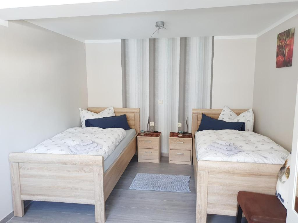 A bed or beds in a room at Fremdenzimmer - Petit Quartier