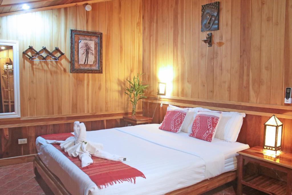 Ein Bett oder Betten in einem Zimmer der Unterkunft Apple Guesthouse