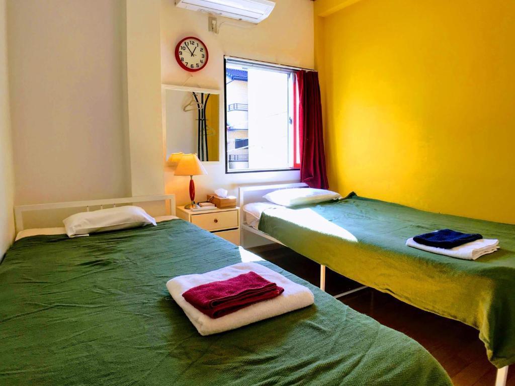 Guesthouse LuLuLu 無料朝食 全室個室にあるベッド