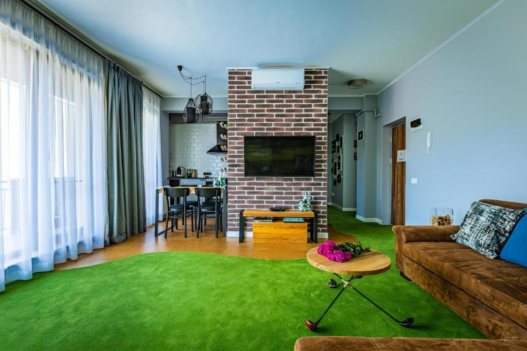 O zonă de relaxare la The Golfer Apartment - Jacuzzi & Panoramic View