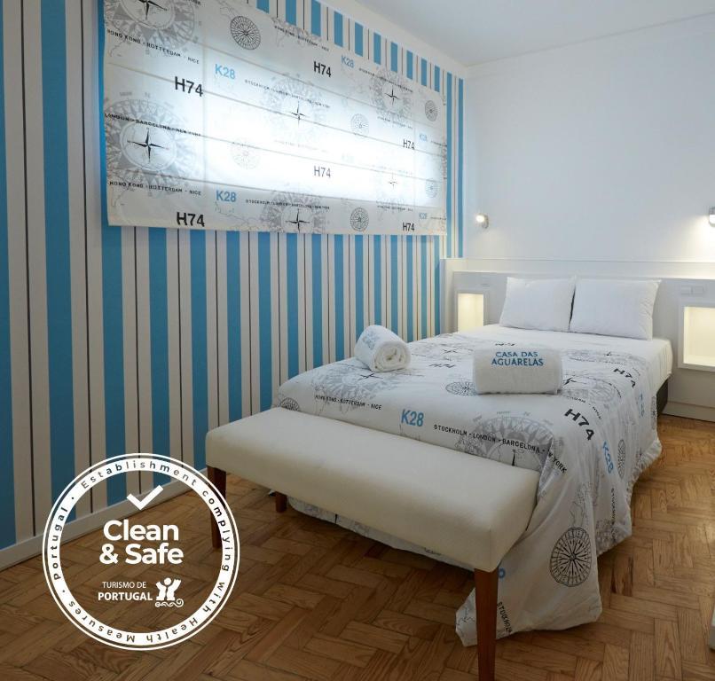 Uma cama ou camas num quarto em Casa das Aguarelas - Apartamentos