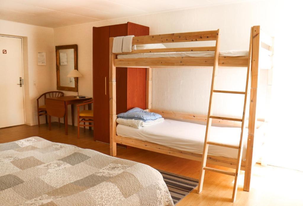 A bunk bed or bunk beds in a room at Børglum Mejeri