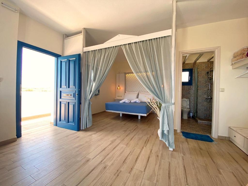 A bed or beds in a room at Michail Suites Afiartis Karpathos