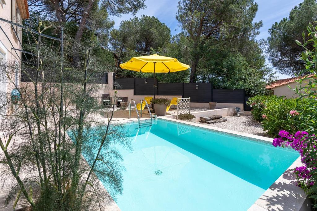 The swimming pool at or near Les Bastides du Haut Para