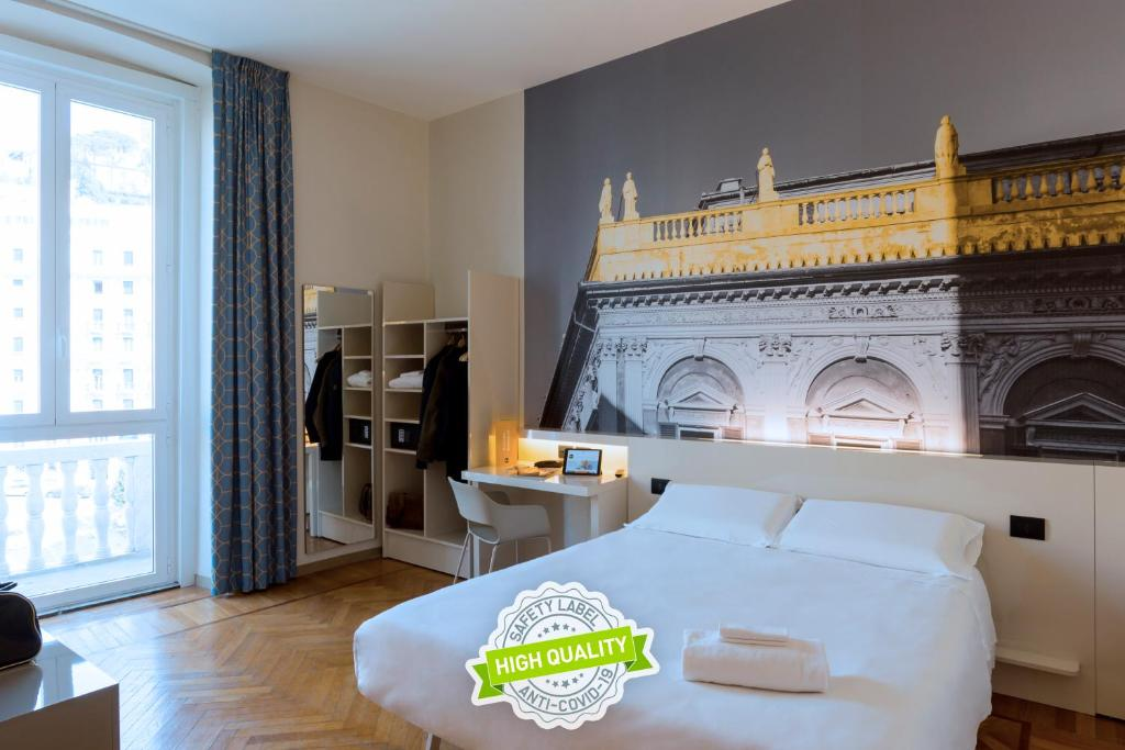 A bed or beds in a room at B&B Hotel Genova