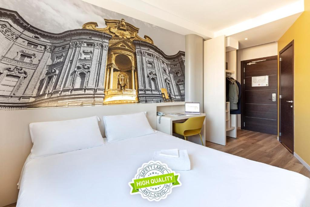 A bed or beds in a room at B&B Hotel Torino