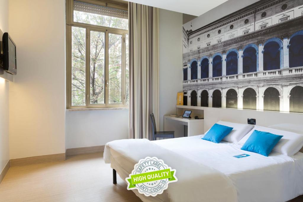 A bed or beds in a room at B&B Hotel Roma Trastevere