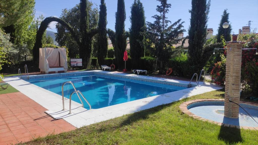 The swimming pool at or near Hotel Rural Puerto Mágina