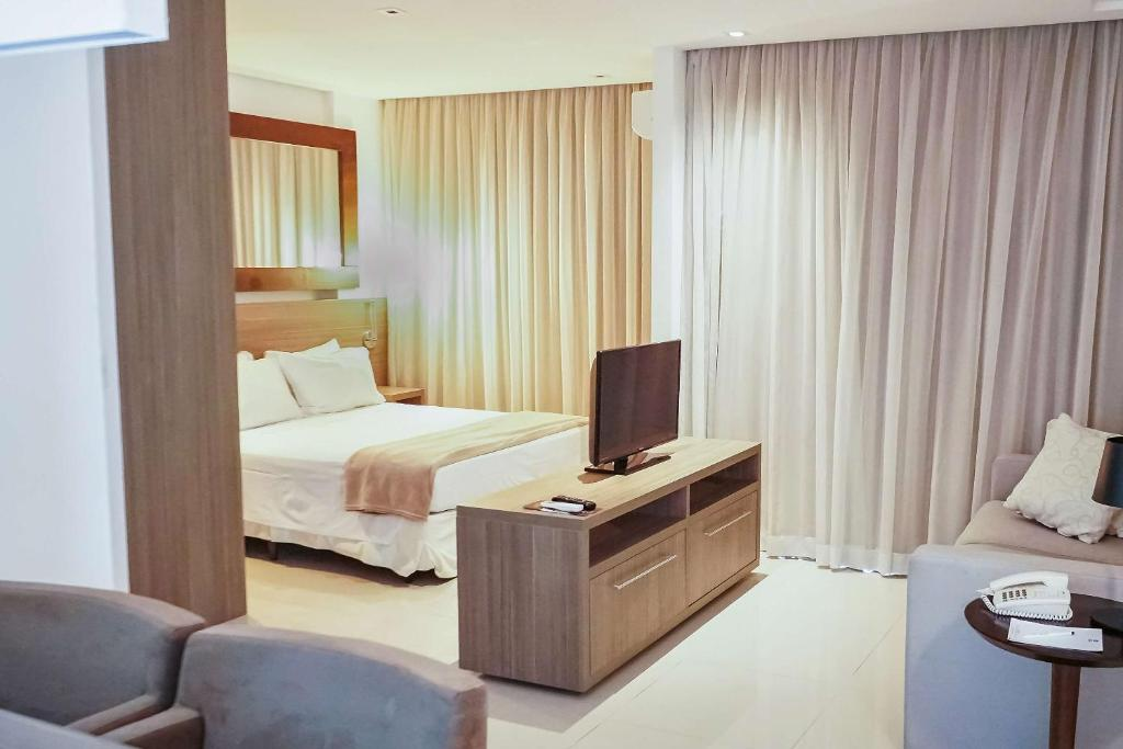 A bed or beds in a room at Samba Rio Convention