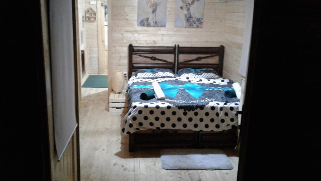 מיטה או מיטות בחדר ב-Nature House צימר