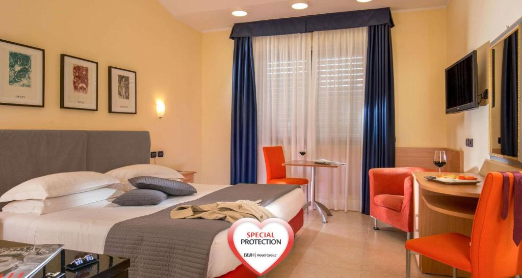 A bed or beds in a room at Best Western Blu Hotel Roma