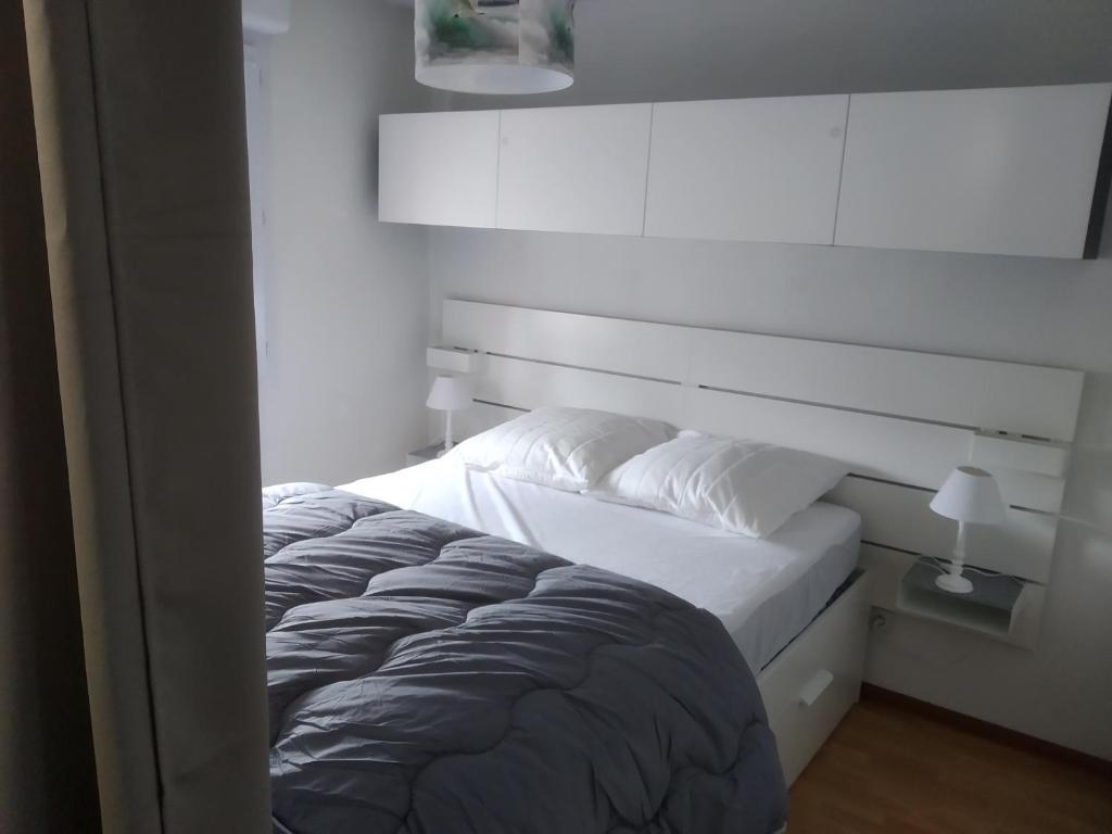 Un ou plusieurs lits dans un hébergement de l'établissement Au Cordouan