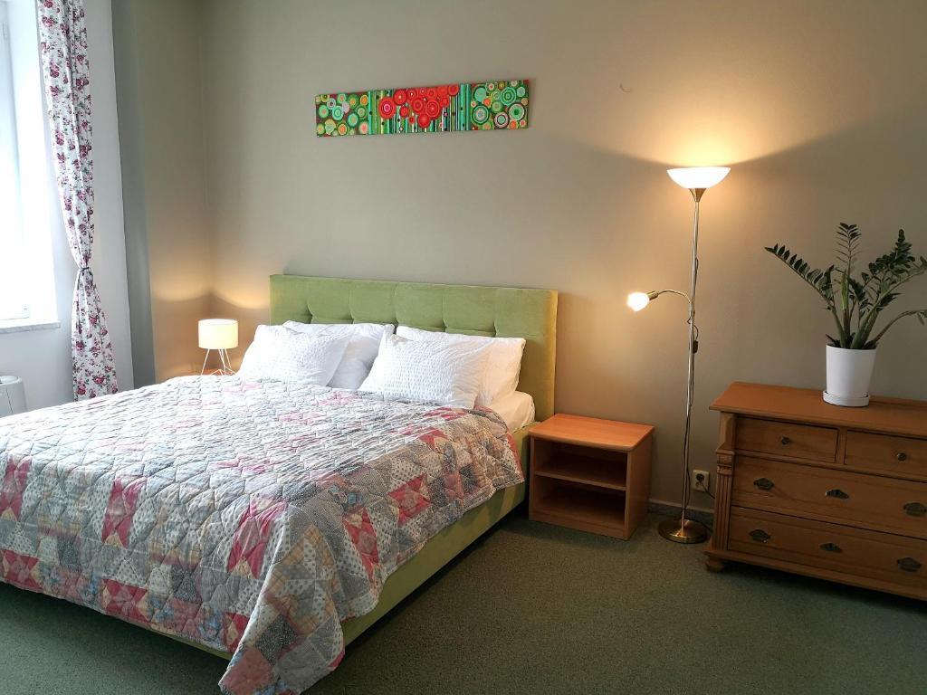 Postel nebo postele na pokoji v ubytování Apartmány Gulliver