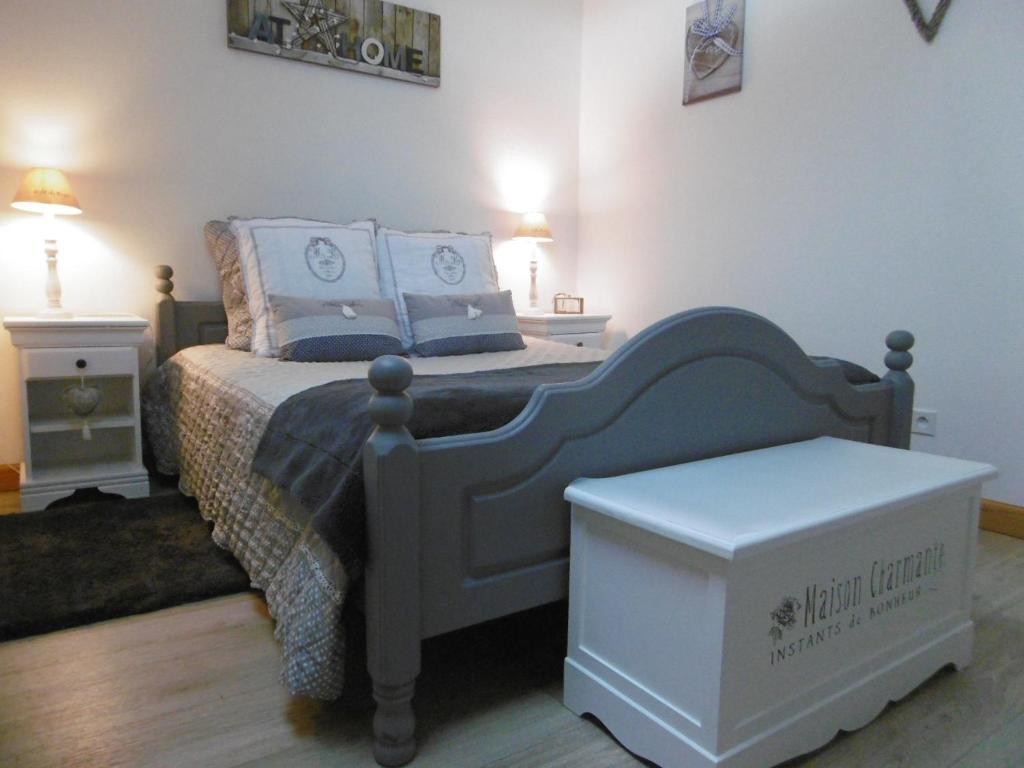 Un ou plusieurs lits dans un hébergement de l'établissement Chambre d'hotes de la Mousse