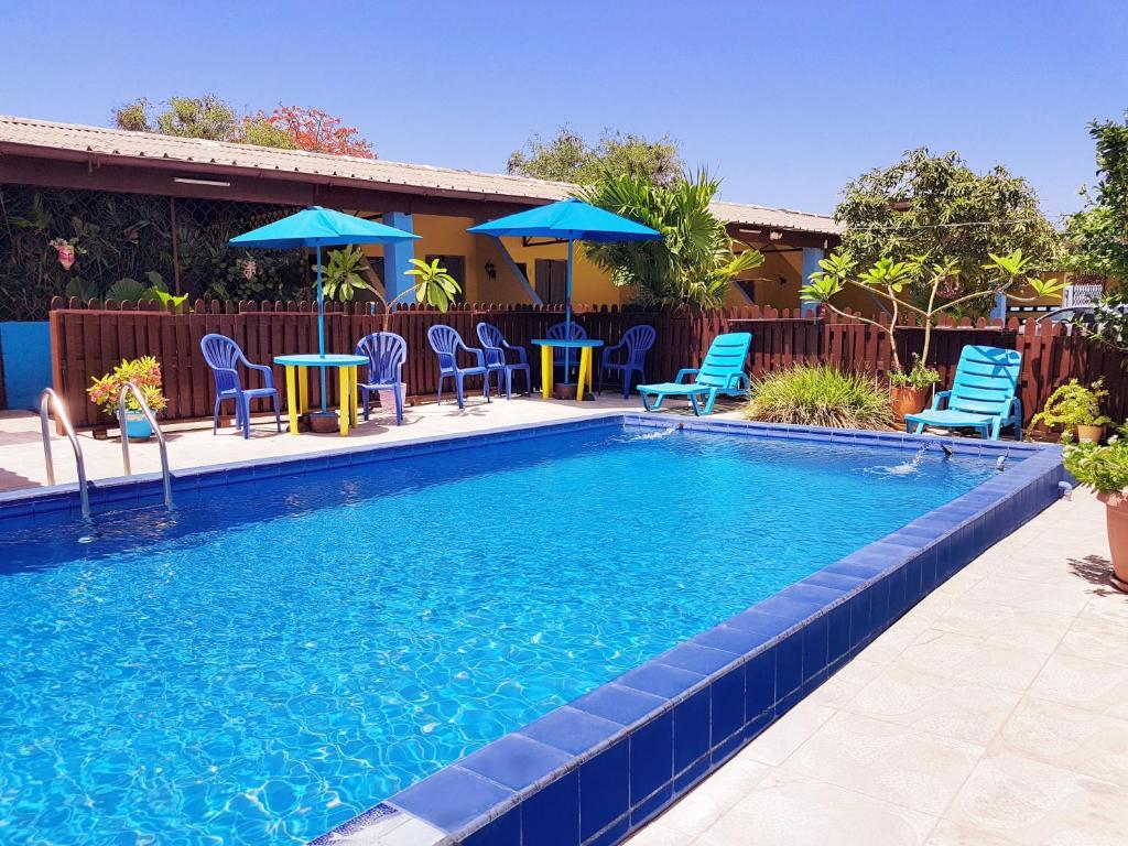 Het zwembad bij of vlak bij Cecil Paradise