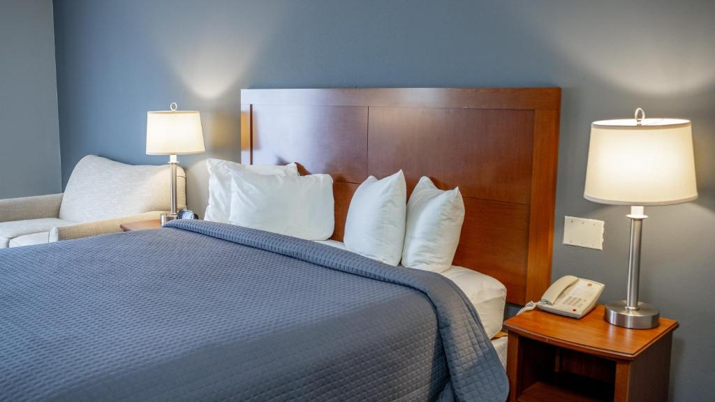 A bed or beds in a room at All Seasons Resort