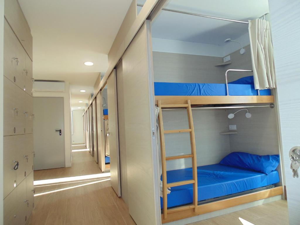 A bunk bed or bunk beds in a room at Hostel Albergue O Mesón