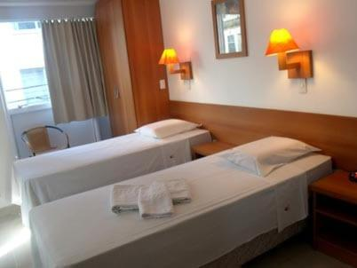 A bed or beds in a room at Hotel Pampa