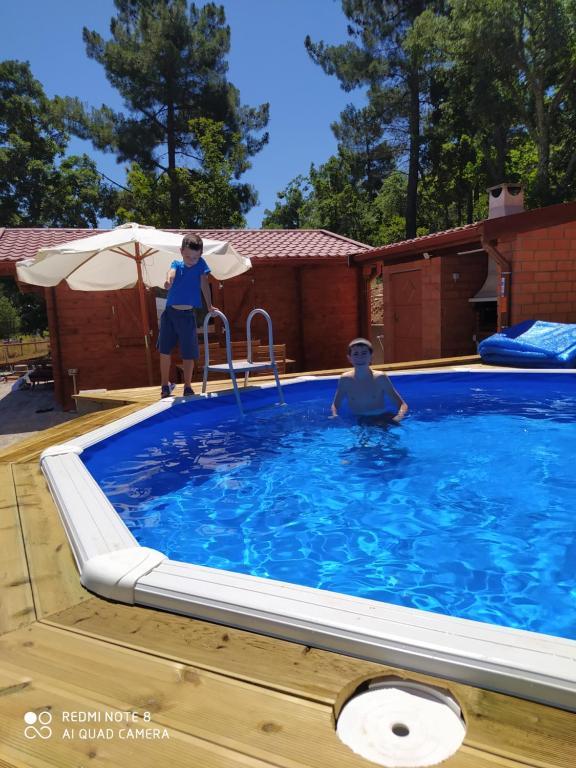 The swimming pool at or near Casa das Vinhas Velhas by Casa do Poço
