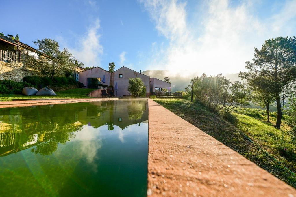 The swimming pool at or near Vale do Ninho Nature Houses