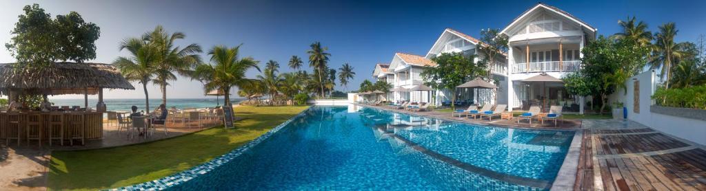 The swimming pool at or near Sri Sharavi Beach Villas & Spa - Level 1 Certified