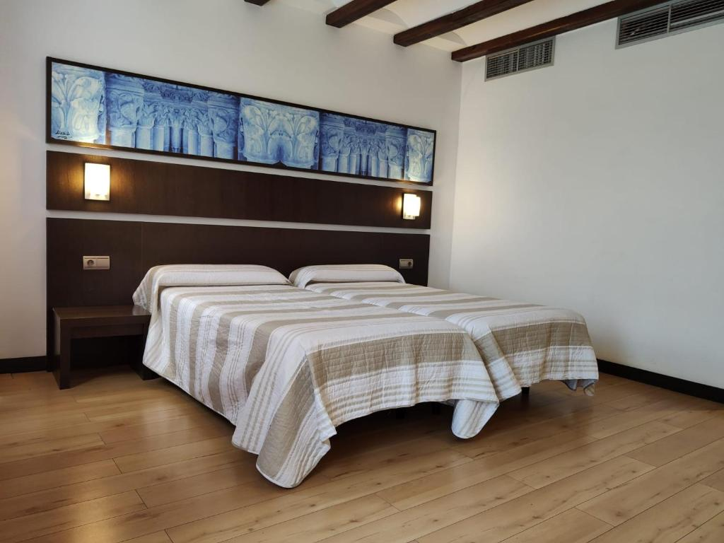 A bed or beds in a room at Hotel Rey Sancho by Vivere Stays