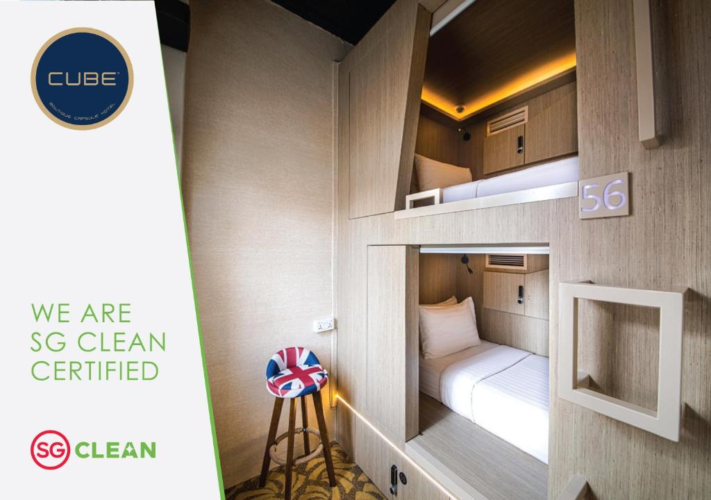 A bunk bed or bunk beds in a room at CUBE Boutique Capsule Hotel @ Kampong Glam (SG Clean)