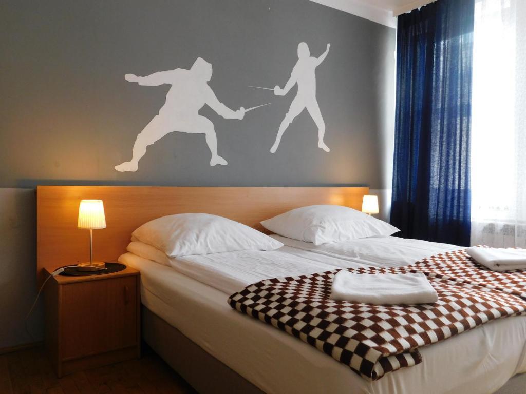 Łóżko lub łóżka w pokoju w obiekcie Pokoje Gościnne Korona