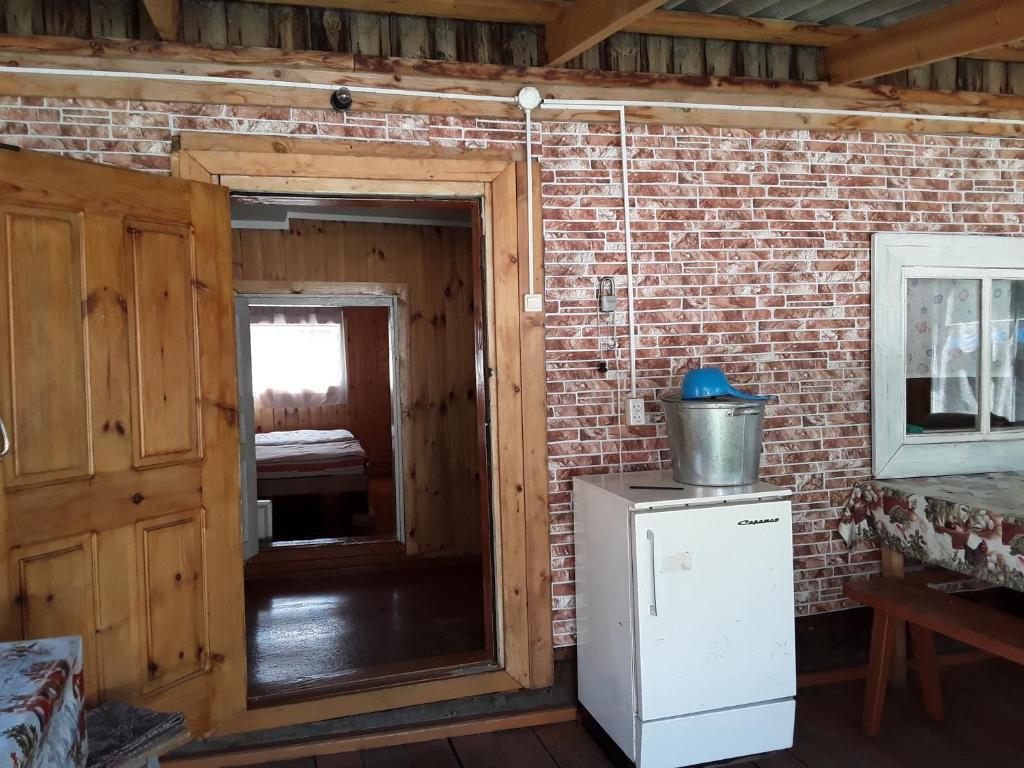 Кухня или мини-кухня в Arshan Guest House