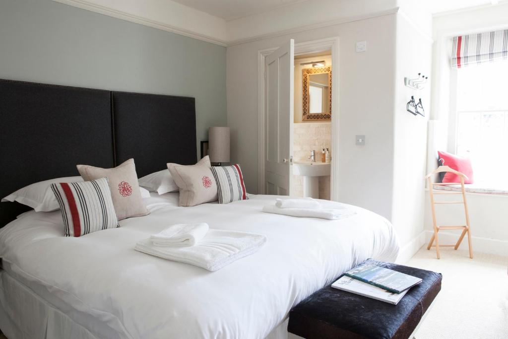 A bed or beds in a room at The Fontmell
