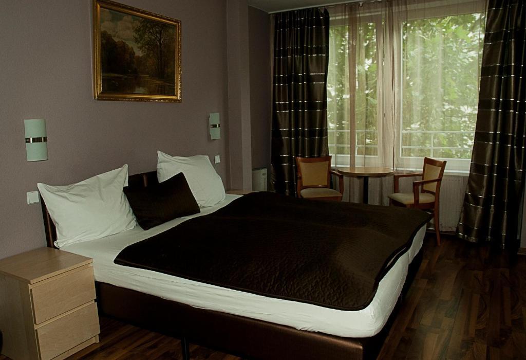 Ein Bett oder Betten in einem Zimmer der Unterkunft Pension Levi