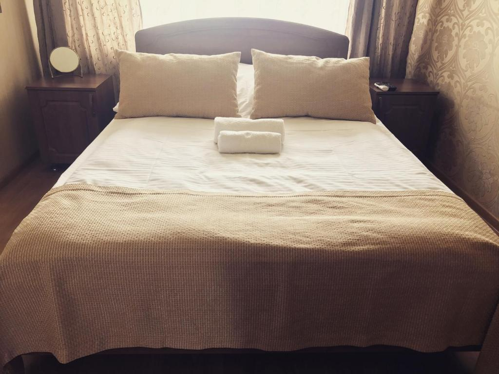 A bed or beds in a room at Dinastiya