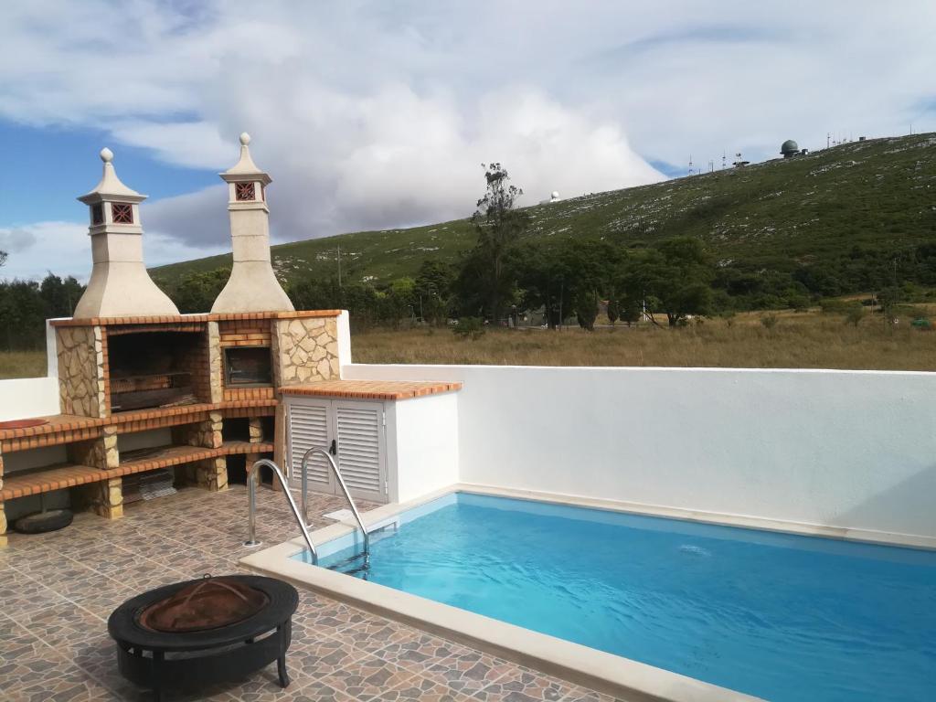 The swimming pool at or near Montejunto Villas-Casa do Esquilo